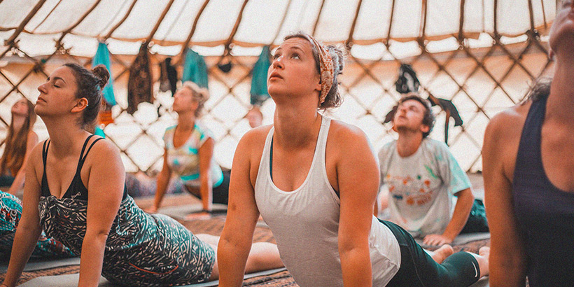 Women doing yoga at Boardmasters